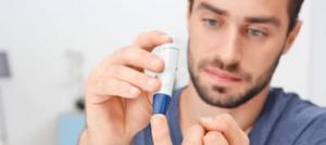 Man checking his blood sugar level